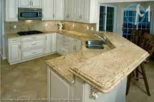 Kashmir Gold Slab Granite shown with a cream colored